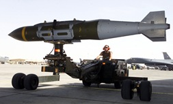 A weapons loader prepares a GBU-31 joint direct attack munition for a mission at a forward-deployed location. Smart bombs like the JDAM have comprised 80 percent of the munitions used during the operation. (U.S. Air Force photo by Staff Sgt. Jessica Kochman - Released).
