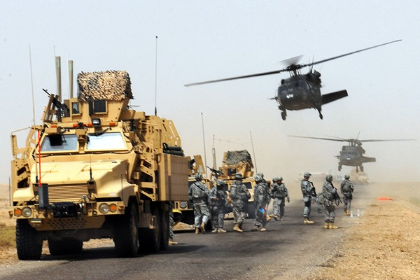 U.S. Army soldiers arrive by air and convoy to help Iraqi soldiers provide humanitarian assistance to the citizens of Faddaqhryah and Bahar in Basra province, Aug. 18, 2009. The soldiers are assigned to the 4th Infantry Division's 17th Fires Brigade.